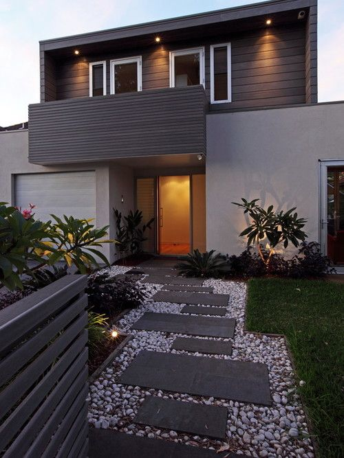 Modern Lawn Area In Small Size Equipped With Stone Walkway Design Equipped With Sliding Glass Door Design With Grey Outdoor Wall Painting Design | http://homewol.com/category/exterior-design/
