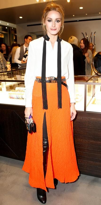 At the Monica Vinader London flagship launch party, Palermo gave her summery orange maxi skirt a winter-ready spin by pairing it with a crisp white long-sleeve neck-tie blouse, black opaque tights, and over-the-knee leather boots. A studded belt (for a touch of edge), a printed clutch, and a selection of Monica Vinader pieces completed her look.