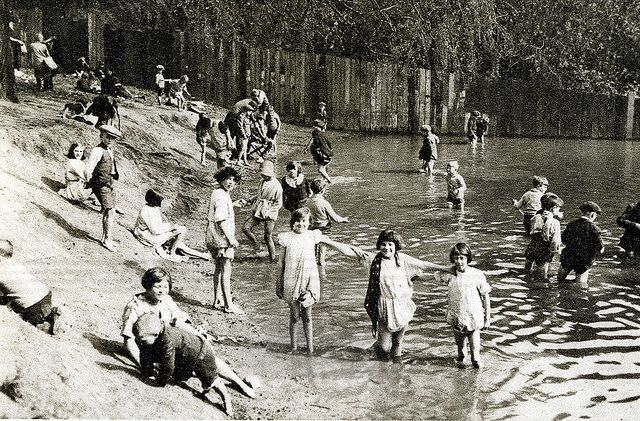 London in the 1920's-Hampstead ponds       Newer Older  On a summer's day, children enjoy splashing about in one of the three Hampstead pond...