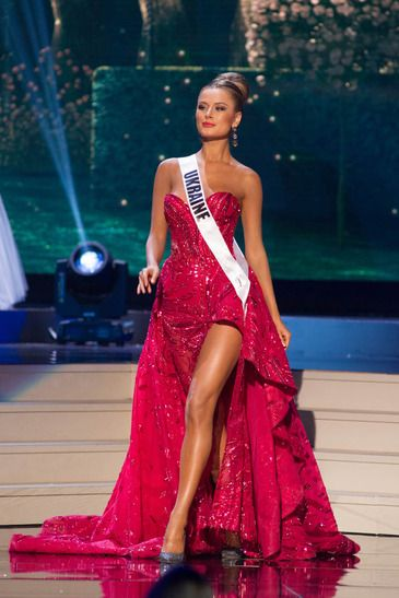 Miss Ukraine Universe 2014 Evening Gown:   Diana Harkusha, Miss Ukraine Universe 2014, rocked this absolutely stunning red Zuhair Murad Fall/Winter 2014 couture evening gown at the Miss Universe 2014 pageant held in Miami, Florida.