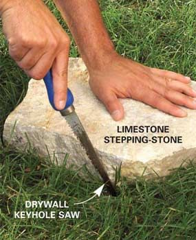 Trace the stone    Place the flagstone where you want it, then cut the outline in the grass.