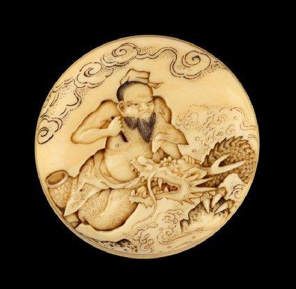 Manjū netsuke depicting the Daoist immortal Bashikō performing acupuncture on a dragon.  Ashmolean Museum.