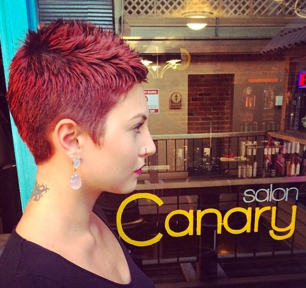 This extra short red pixie was shaped to look feminine and beautiful ...