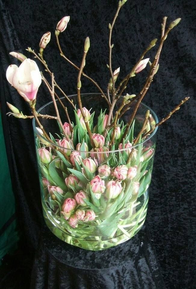 Pretty comination of tulips and Japanese magnolias for a  table centerpiece