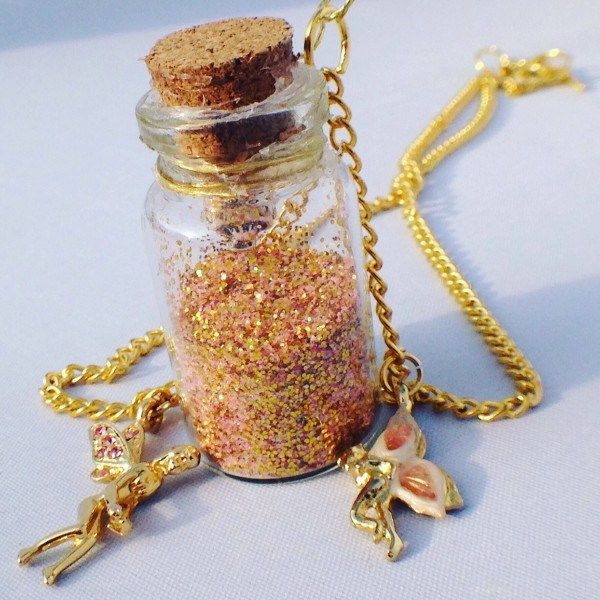 Gold fairy dust jar necklace with pink enamelled fairies