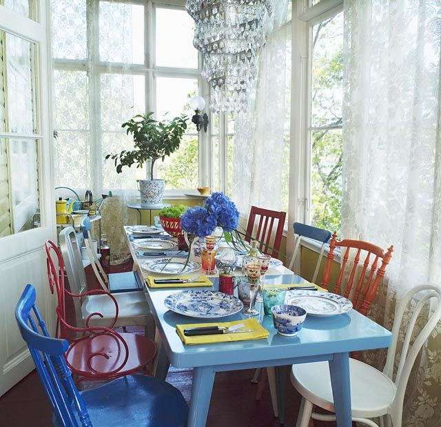 Colorful table and chairs in sunroom with lace curtains Scandinavian Interiors   Inspiring Interiors