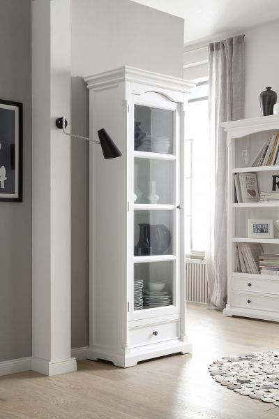 There are some designs that work in a multitude of ways but this glass cabinet looks its best when it's used as intended – to display. With traditional features, from the cornice and side panels to the moulding that picture-frames the glass, it really is a piece inspired by the past. In a living area, store decorative accessories, photo frames and a mini book collection, or crockery, cups and glassware to create a slimline dresser in a kitchen.