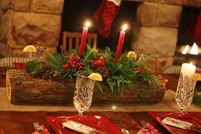 Christmas centerpiece. Find log drill holes for candles. Add garland and pine cones (flocked)