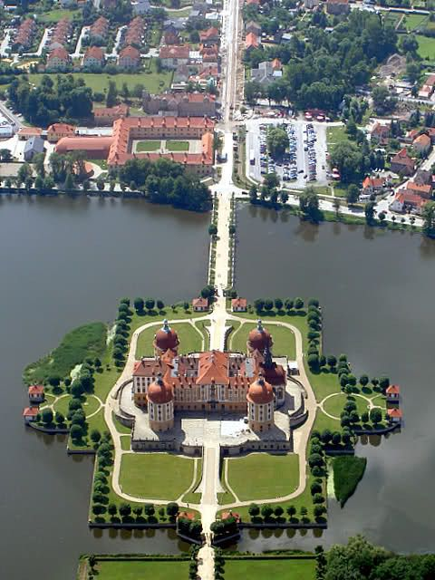 Castle Moritzburg, Dresden, Germany. The castle has four round towers and lies on a symmetrical artificial island. It is named after Duke Moritz of Saxony, who had a hunting lodge built there between 1542 and 1546. The surrounding woodlands and lakes have been a favourite hunting area of the electors and kings of Saxony.