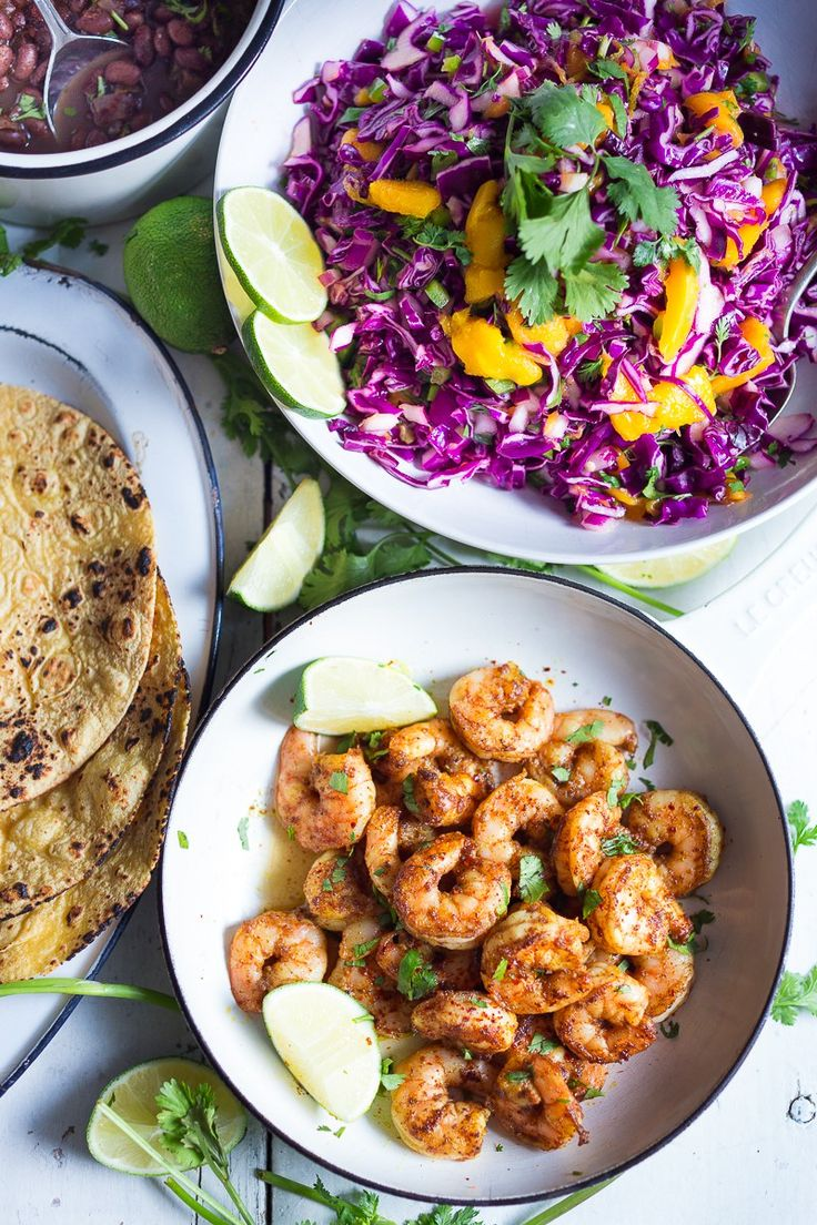 Caribbean Shrimp Tacos with a Mango Cabbage Slaw- bursting with Caribbean flavor! Healthy and can be made in 30 mins!| www.feastingathome.com