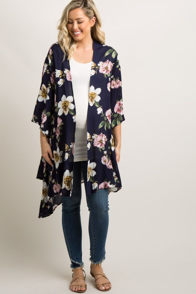 1cca9031fb7c3 Navy Floral Asymmetrical Draped Kimono A floral print maternity kimono with  an asymmetrical draped hemline, wide 3/4 sleeves, and an open front.