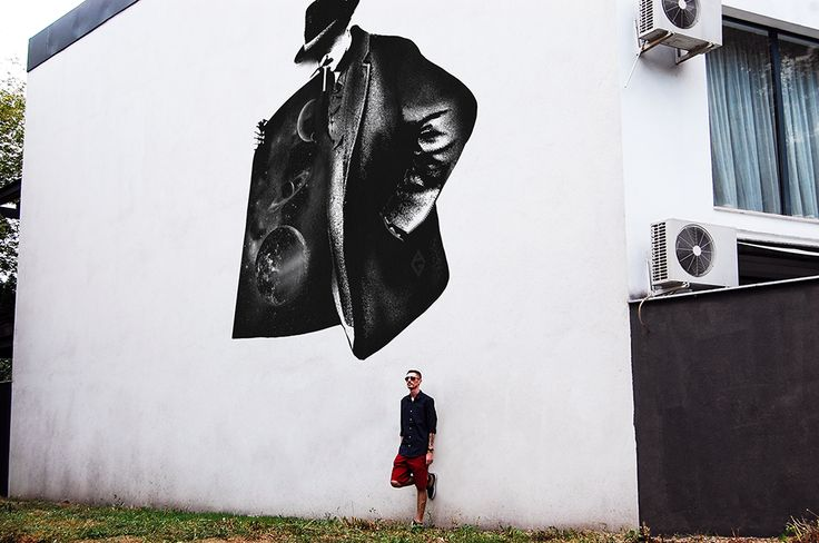 The Man who stole the Universe on a wall in Bucharest.