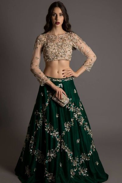 cream and green lehenga, skin color full sleeves blouse, darg green skirt, silver embroidery