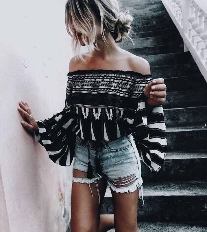 Pretty black and white off the shoulder top with distressed denim shorts.