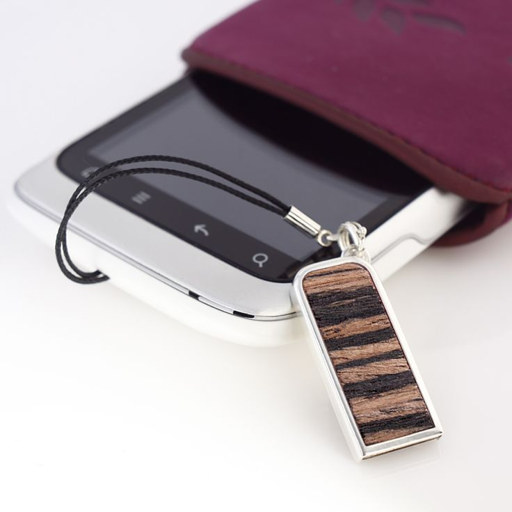 ZaNa Mobile Flash Teak is a very neat stick specifically designed as a pendant to your mobile phone. The metal casing of this little miracle is covered with a layer of pure silver, 999 fineness Complementing the unique design are used inserts with exotic Teak wood