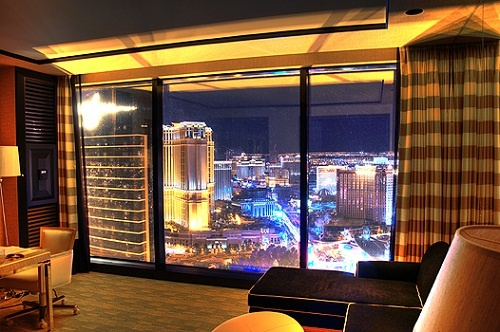 """The latest addition to the Wynn Hotel in Las Vegas, Encore is its own tower on the North end of Steve Wynn's property. This view is at night, South down The Strip, from Room 55-10. The original Wynn tower is visible, along with The Venetian, and Treasure Island on the right."""