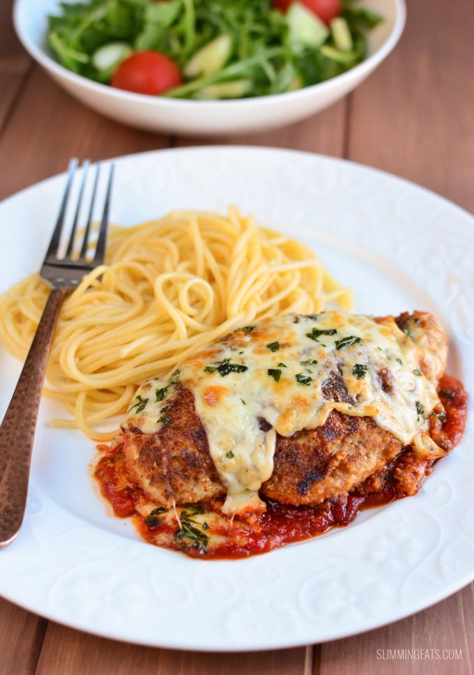 Chicken Parmesan - Tender Chicken breast, coated in breadcrumbs, rich tomato sauce and topped with cheese and baked till golden