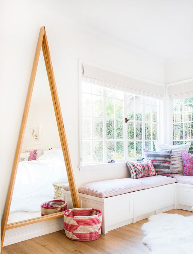 Add a touch of fun to your bedroom with an oversize geometric mirror.