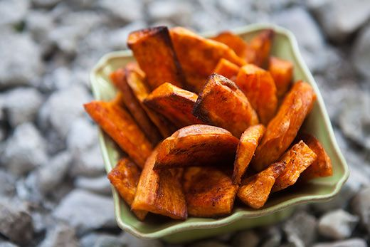 Wedges or slices of sweet potatoes, tossed in olive oil, sprinkled with spices, and baked on high heat until crispy and browned. Addictive!