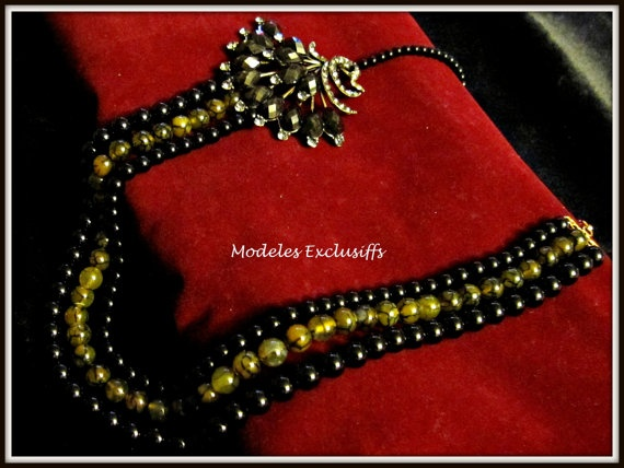 Black only and dragon veined 3 layered necklace with a peacock side pendant with crystals and faceted onyx