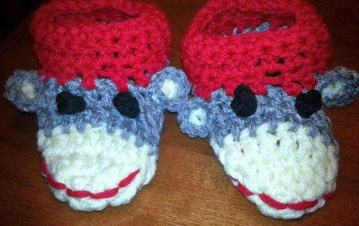 Just off the hook, MONKEY SLIPPERS  Keep those little toes warm and cosy this winter and the cute little monkey face will create a smile for the whole family!