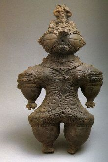 Another Jomon ceramic Shako Dogu.  A mystery.  This shako dogu appears to be wearing some sort of armor or clothing that is unlike anything seen throughout history. What sort of mind could have imagined such a thing, especially if the culture had no conception of clothing aside from the hides of beasts?