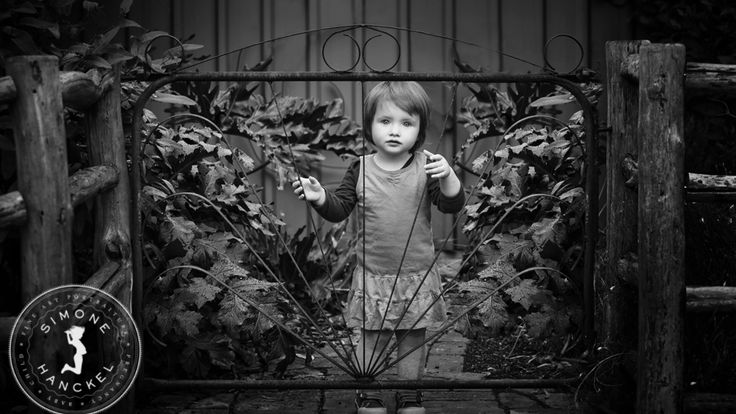 This photograph is absolutely haunting, but in reality was this little sweetie playing with the gate! Her eyes are magical :) © Simone Hanckel Photography