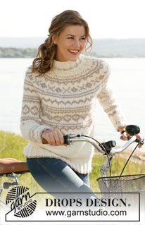 """White Chocolate - Knitted DROPS jumper with round yoke and Norwegian pattern in """"Eskimo"""" or """"Andes"""". Size: S - XXXL. - Free pattern by DROPS Design"""