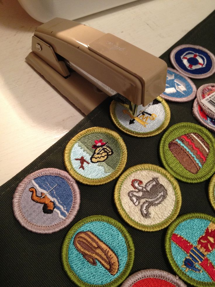 Sewing Boy Scout Merit badges- these are a pain to pin into place, so staple, sew, then remove the staples....genius ...wish I thought of this before!