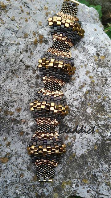 """Bumpy road"" bracelet. Designed and beaded by Beaddict. Seed beads, Miyuki triangle beads, cube beads."