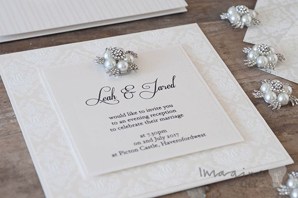 Elegant wedding invitation with crystal and pearl embellishment. DIY wedding invitations