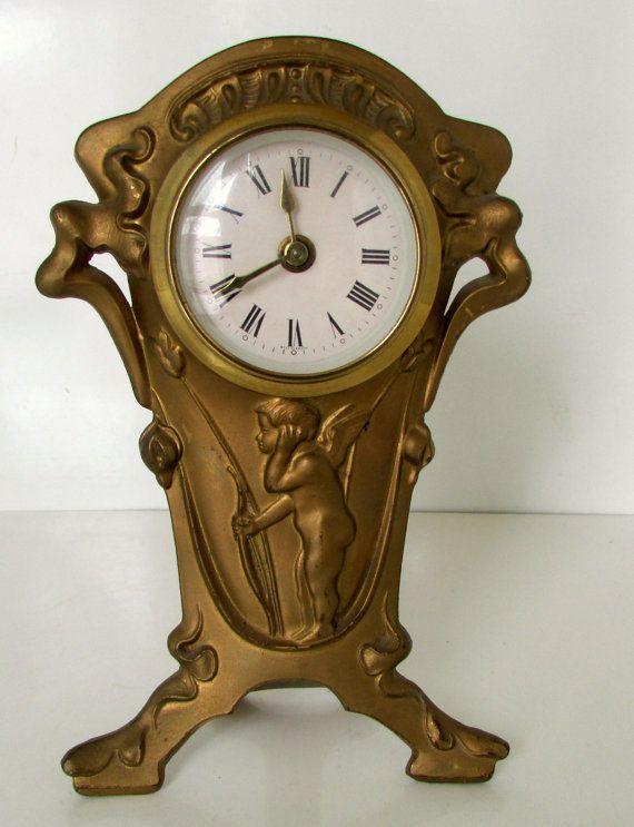Art Nouveau Clock Cupid With Bow And Arrow Cast Iron Clock