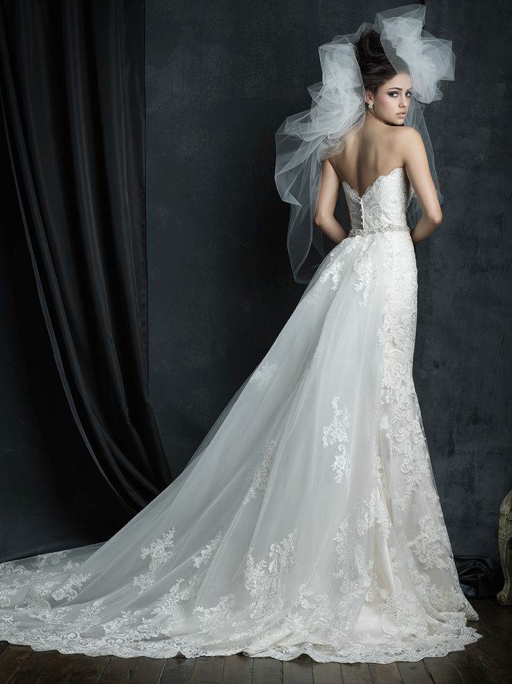 This strapless lace gown features a gorgeous detachable train // Allure Couture C387