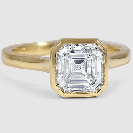 A sleek and modern asscher cut diamond engagement ring