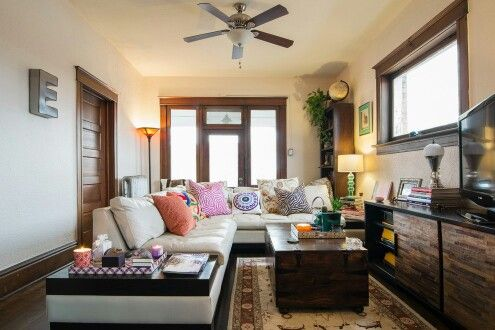 Rich, full use of the given space with decor and pastel on walls with shades in decor makes it an interesting cozy space