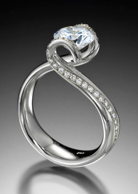 Setting price starts at $3,690 (without center stone) Sonata ring has lyrical lines & the feeling the romance. This unique engagement ring features a tension set center stone accented by .33 carats total weight of diamonds pavé set in white gold. Call us at (949) 715-0953 to purchase or click below for additional information.