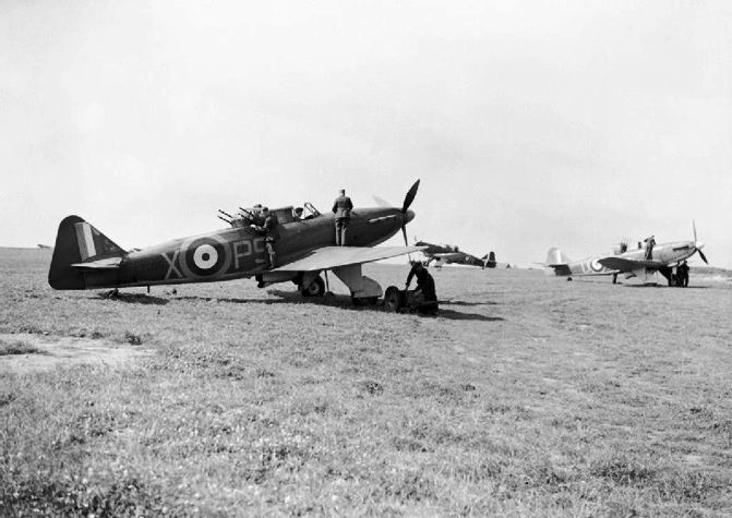 Defiant Mk I PS-X of No 264 Squadron RAF is prepared for take-off by ground crew at RAF Kirton-in-Lindsey in July 1940. The aircraft was crewed by pilot P/O Eric G Barwell and LAC James E M Williams when they destroyed an Me 109 on 29 May and accounted for 2 Ju 87 dive bombers on a second patrol. Operating from RAF Manston in support of the evacuation of the BEF from Dunkirk, the crews were credited with shooting down 37 enemy aircraft on the day.