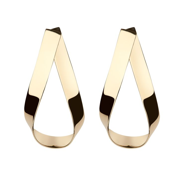 These high polished statement earrings are the perfect addition to your wardrobe. The Script Doorknocker Earrings are oversized but very wearable. We love them with a t-shirt and jeans. Fall '17 Collection Available in 14K Yellow gold Plated Brass