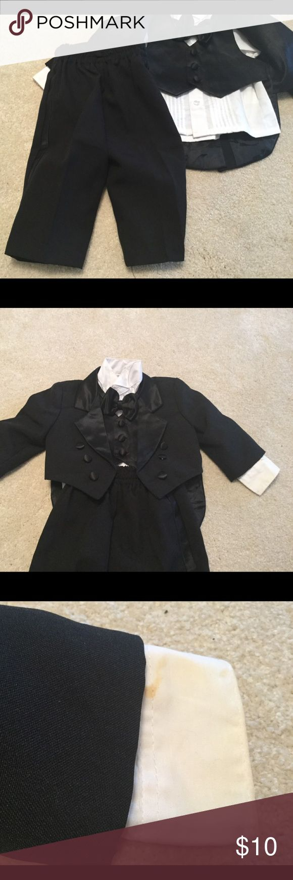 Size small baby boy tuxedo Used tuxedo size small, shirt has stains on cuff. This was not used by me, got it in huge clothing buy out . Maybe could be bleached off.  No refunds or returns Matching Sets