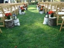 lining the aisle with birch trunks topped with candles
