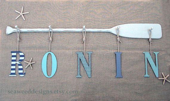 "58"" Paddle 5-Peg Name Rack Painted or Stained with 9"" Decorative Baby Name Letters.  See this and more at seaweeddesigns.etsy.com"