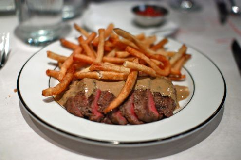 """The culotte steak (top sirloin cap) was topped with the restaurant's """"secret sauce"""" and served with a generous heap of frites. Description from dmvdining.com. I searched for this on bing.com/images"""