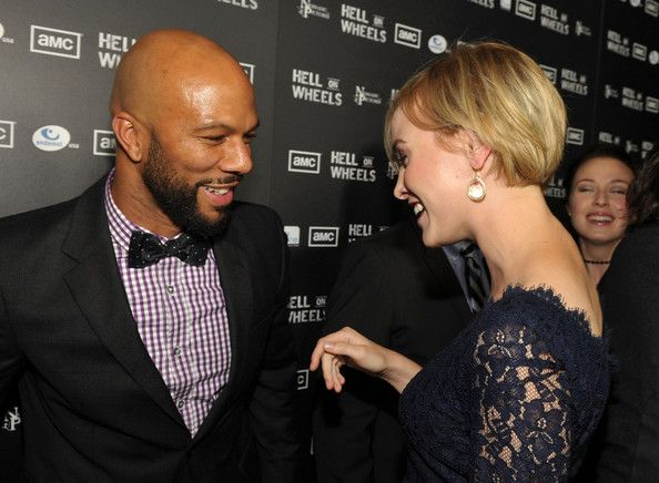 """Actors Common (L) and Dominique McElligott arrive at the premiere of AMC's """"Hell On Wheels"""" held at LA Live on October 27, 2011 in Los Angeles, California."""