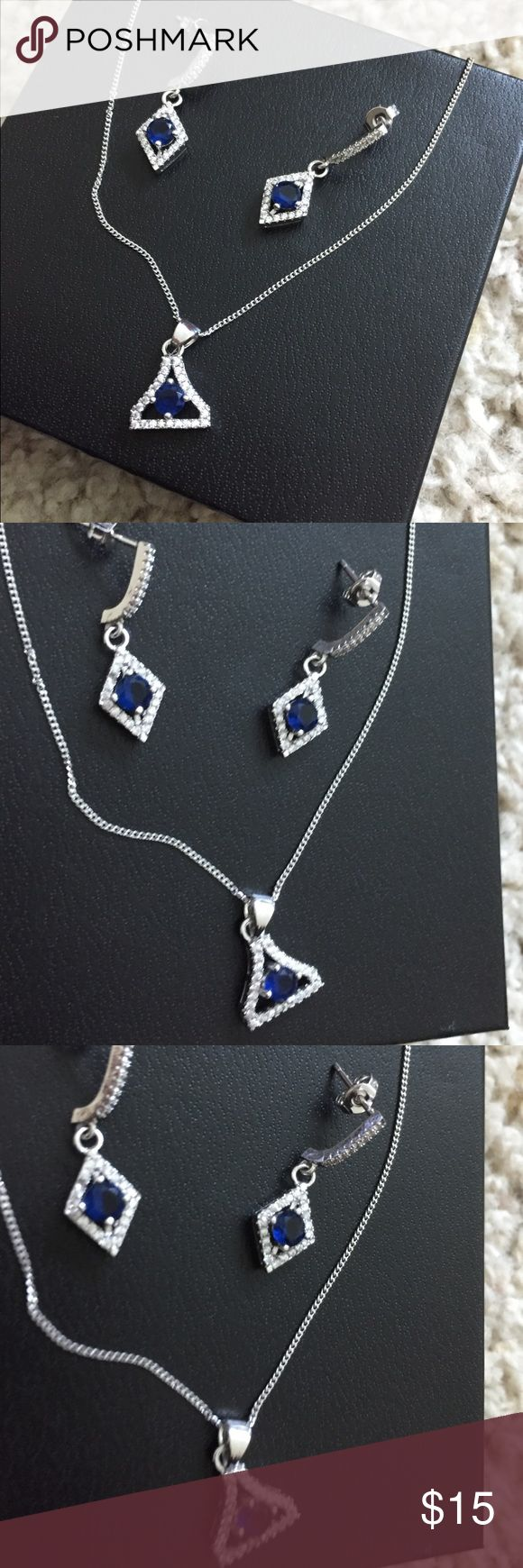Genuine crystal, navy blue necklace/ earrings set Genuine crystal, navy blue necklace and earrings set. Brand new. Bought for me randomly by my boyfri…