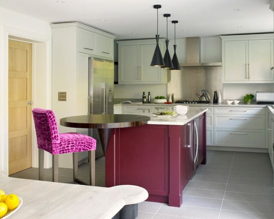 Contemporary shaker style kitchen with custom made white cabinets, deep red island with round breakfast bar and upholstered stool.