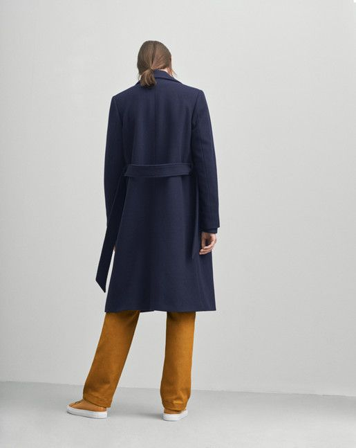 A classic collar coat in a soft wool. Slightly A- line shape with a tone in tone…