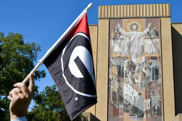Sep 9, 2017; South Bend, IN, USA; A Georgia Bulldogs fan holds a flag in front of the Word of Life mural, commonly known as Touchdown Jesus before the game against the Notre Dame Fighting Irish at Notre Dame Stadium. Mandatory Credit: Matt Cashore-USA TODAY Sports