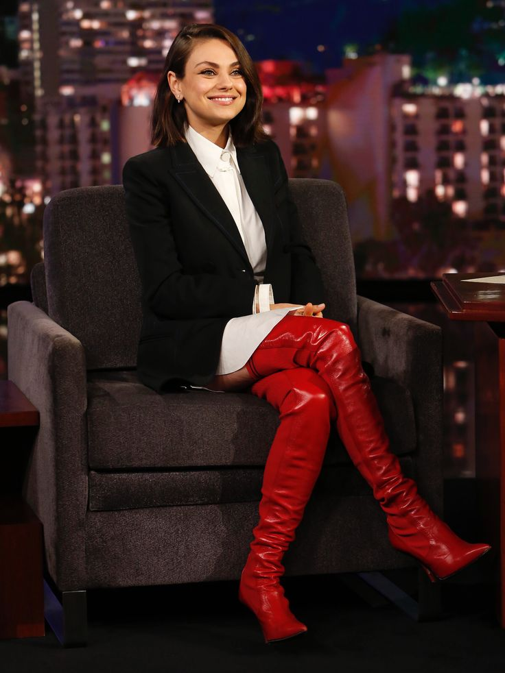 Mila Kunis crossed legs in red thigh high stiletto boots