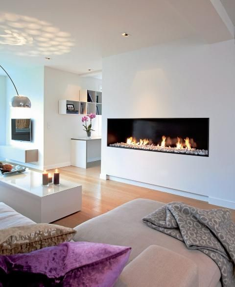 LOVE this modern fireplace. It's on my list .... Must have