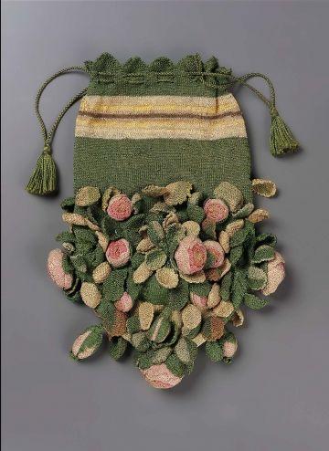 """Rose Bud"" drawstring bag. Green silk knit with ecru/yellow/brown band at top, light green at base; appliquéd pink, salmon roses and light green, green, ecru leaves. Green corddrawstring."